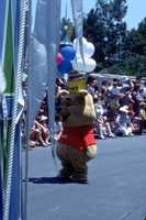 1977: Pooh walks the parade route inside the Magic Kingdom.