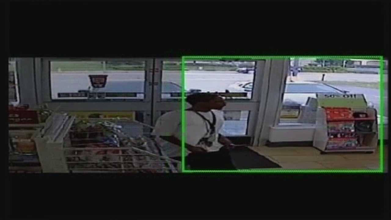 Police are looking for at least two people who they said stole a purse from a woman's purse as surveillance cameras were rolling.