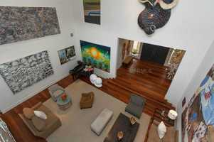 This downward view of the living room from the second floor balcony shows off the room's size.