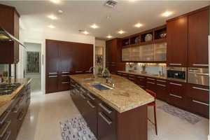 Expansive chef's dream kitchen featuring top-of-the-line appliances and granite counters.
