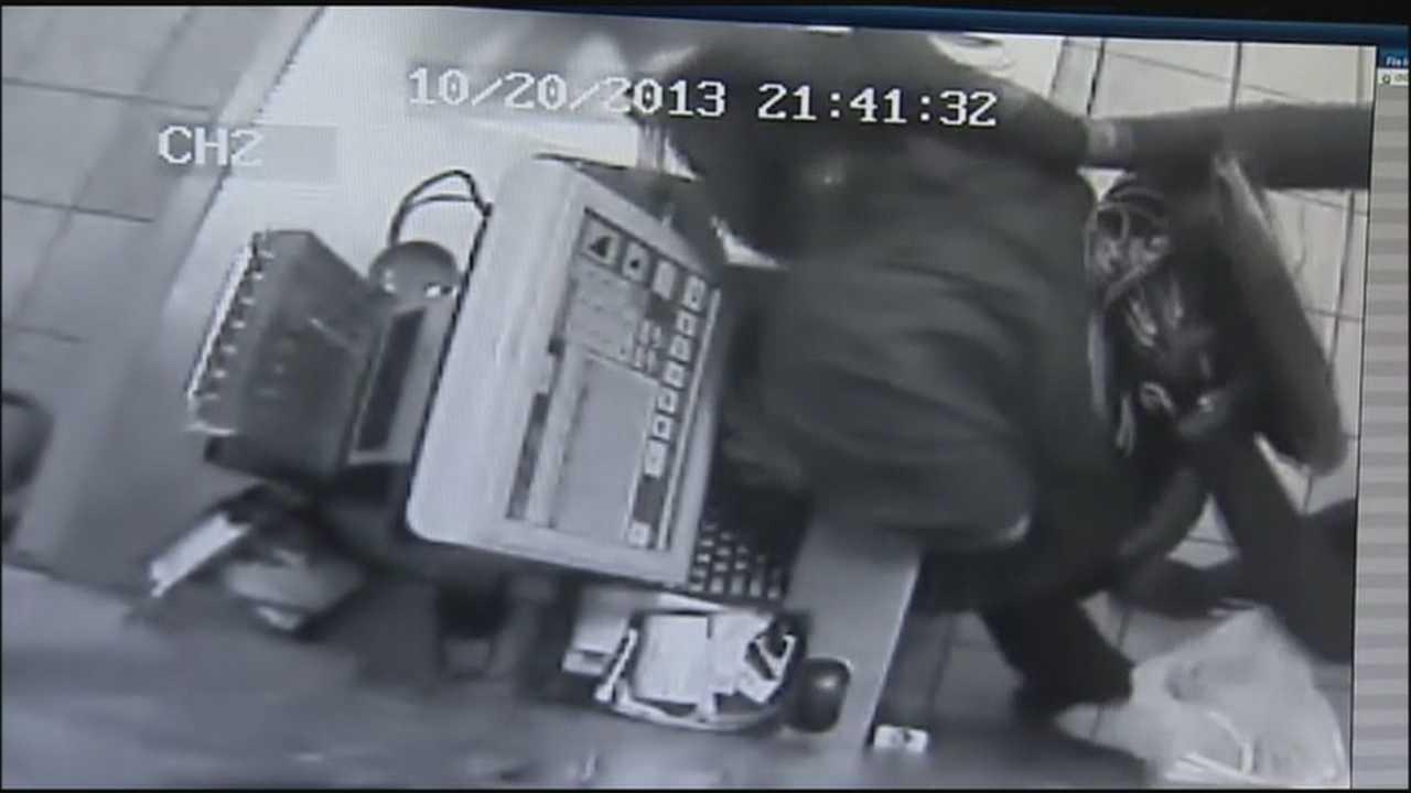 Surveillance shows spandex-clad robber attack Subway worker