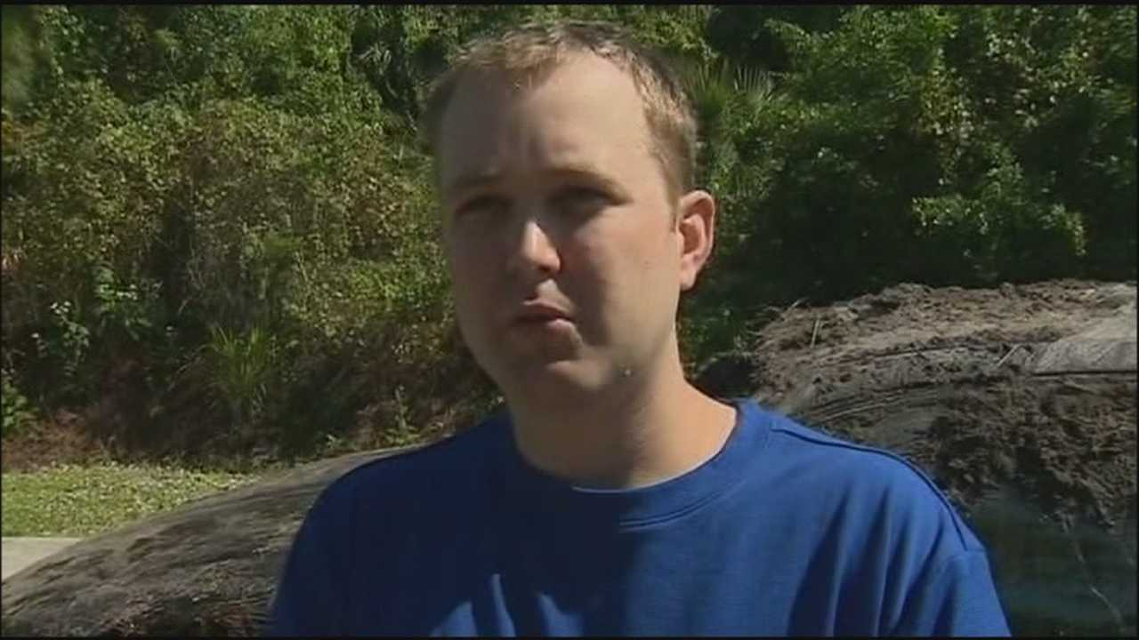 A pizza delivery driver jumped in a watery ditch to help save the life of a woman who crashed.