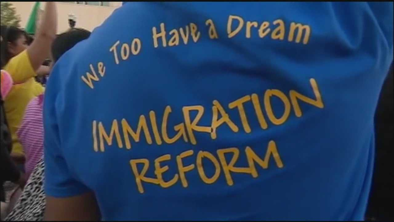 img-Immigration reform marchers block downtown intersection