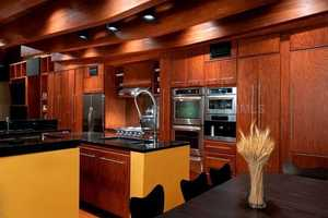 Just as the rest of the home, the kitchen features exquisite woodwork. The cabinetry and professional appliances will be beloved by any chef.