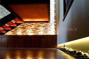 Accent lights throughout the home showcase its natural accents.