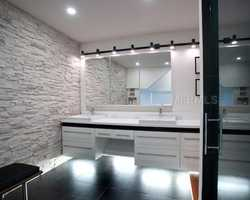The master bathroom also includes dual vanity sinks.