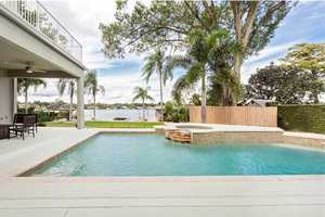 Ground level pool and jacuzzi is steps from the lake.