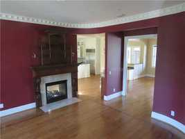 Steps from a freshly remodeled kitchen is the two-sided fireplace in the living room.