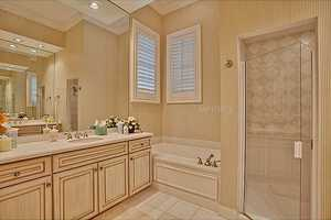 The guest suite's bathroom is comparably plush.