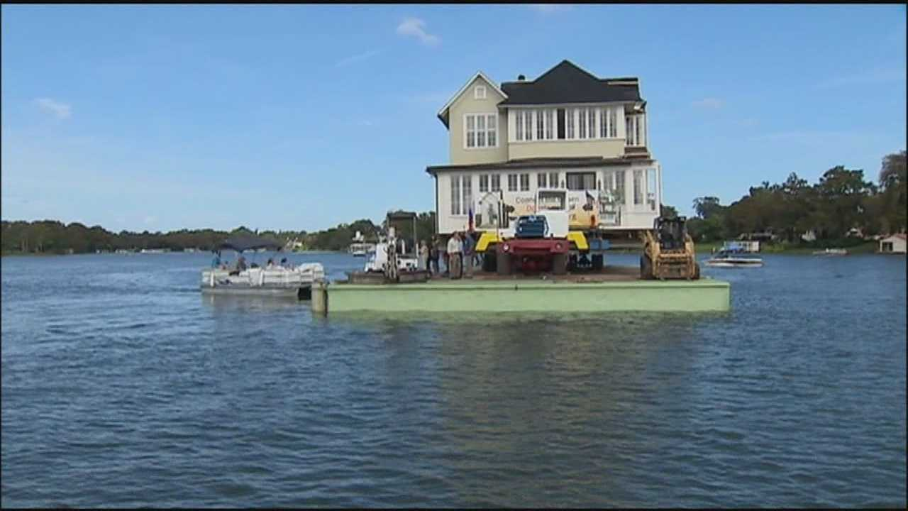 It's a big day for Winter Park's historic Capen House, as half of the building moved across Lake Osceola to a new location.