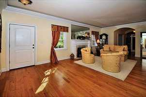 Hardwood floors and warm-family decor greet you at the front door.