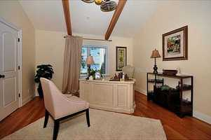 The master suite also includes a private office.