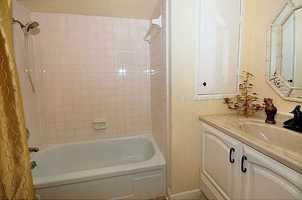 Custom bathroom features spectacular vanity.