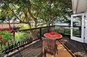 A shaded balcony sitting area.