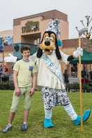 "Nolan Gould, Luke Dunphy on ABC's ""Modern Family,"" celebrated the new year with Father Time Goofy at Disney's Hollywood Studios."