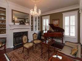 The living rooms include elegant fireplaces and chandeliers.