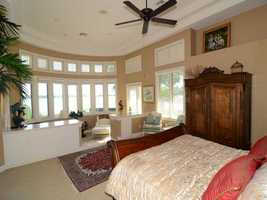 The master bedroom includes a separate sitting area where you can enjoy panoramic lake views.
