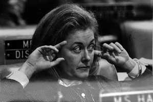 Representative Mary Ellen Hawkins plugs her ears.
