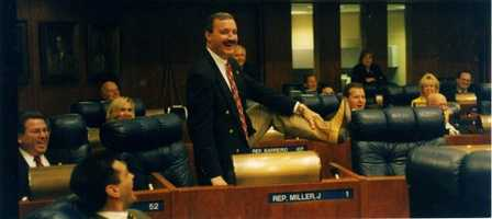 Representative Miller showing off his boots.