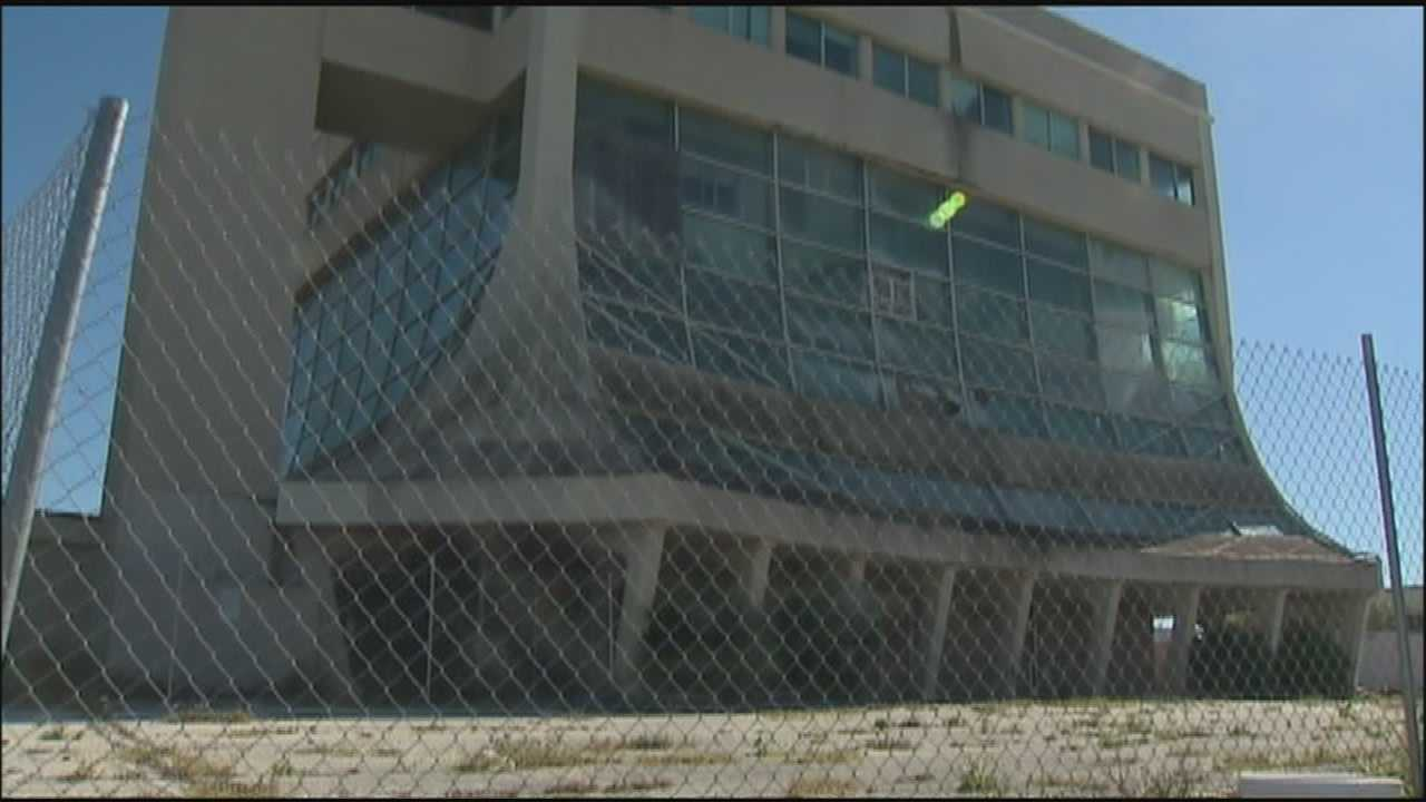 A historic building that's become an eyesore in Cocoa Beach is closer to destruction, but a man who owns a penthouse in the building is fighting it every step of the way.
