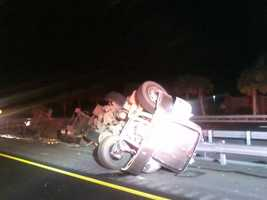 According to the Florida Highway Patrol, the driver of the truck, that was carrying 45,000 pounds of tar, over-steered to avoid hitting a vehicle that had stopped to avoid hitting a ladder. The truck hit a guardrail and overturned, but only 20 gallons of tar spilled on the roadway.