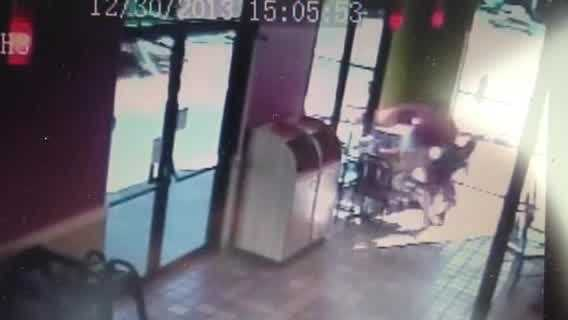 Raw video: SUV crashes into Popeye's restaurant