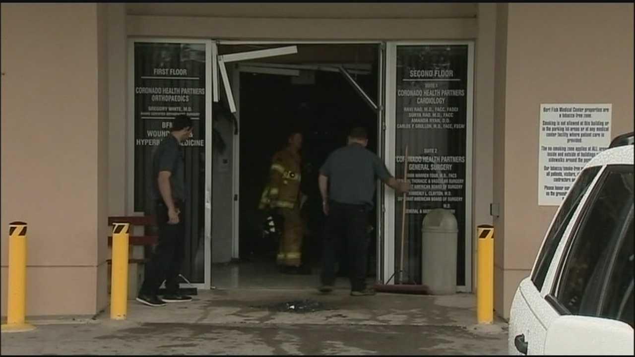 Man killed, 2 women injured after car plows through building