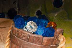 "A bucket of jewels much like the ones seen in the Disney classic ""Snow White,"" part of the Seven Dwarfs Mine Train attraction."