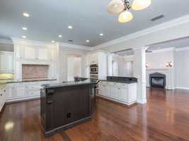 The spacious kitchen, adorned with upgraded appliances is a fantastic addition to this home.