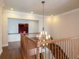 Gorgeous hardwood floors and bannister.