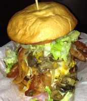 """2. Beth's Burger Bar: DD Challenge BurgerWhat's on it: 4 patties, 8 slices of bacon, 5 different cheeses, and then topped with grilled onions and mushrooms, lettuce, tomato, pickles, ketchup, mustard and mayo.If you eat the burger within 10 mins you get a t-shirt that says you """"Conquered the DD Challenge."""" Those who complete the challenge get their picture taken to be put on their """"Wall of Fame.""""Address:24 E. Washington St, Orlando, FL 32801"""
