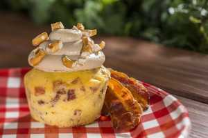 Grab a piggylicious bacon cupcake topped with maple frosting and a pretzel crunch from The Smokehouse: Barbecue and Brews Outdoor Kitchen in The American Adventure pavilion courtyard. Food and beverage items will be available at 11 locations around the World Showcase promenade.