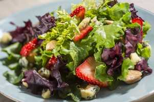 This salad features local Plant City strawberries, almonds and Farmstead stilton. It is available at the Buttercup Cottage Outdoor Kitchen in the United Kingdom pavilion.