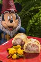 The pork and apple sausage roll is featured at the Buttercup Cottage Outdoor Kitchen in the United Kingdom pavilion.