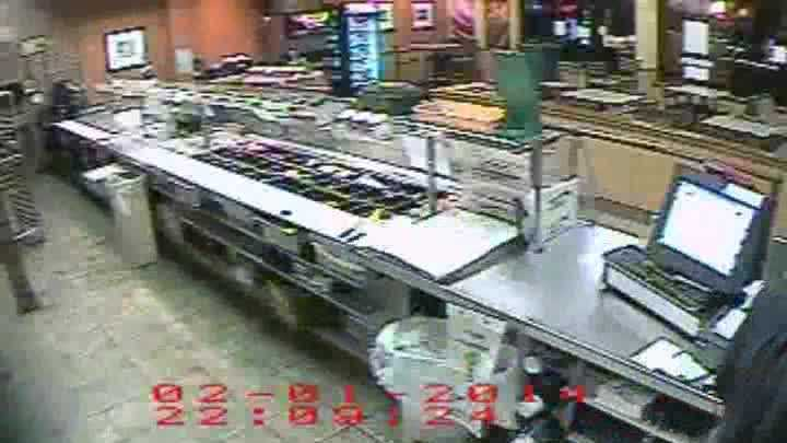 Surveillance video: Subvway robber cause on camera