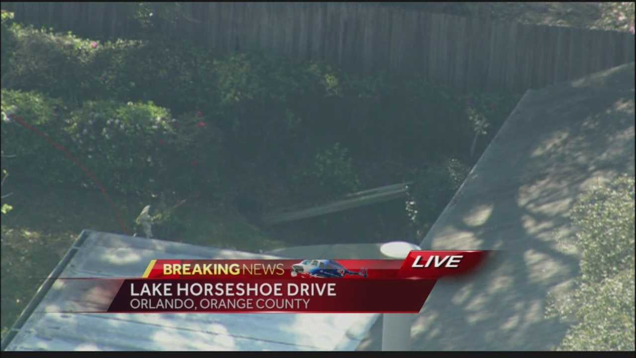 Orange County Fire Rescue officials are investigating a sinkhole off Lake Horseshoe Drive.