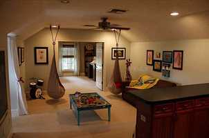 The master bedroom suite includes an adjacent nursery or den area.
