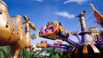 35. Magic Carpets of Aladdin: Guests can climb aboard a colorful, 4-passenger vehicle and take off into the air while rotating around a giant genie bottle and magic lamp.Location: AdventurelandHeight: Any