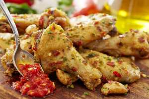 Spicy Calabrian Wings are tossed with garlic and chili peppers from the Italian region of Calabria, served with Gorgonzola dipping sauce.