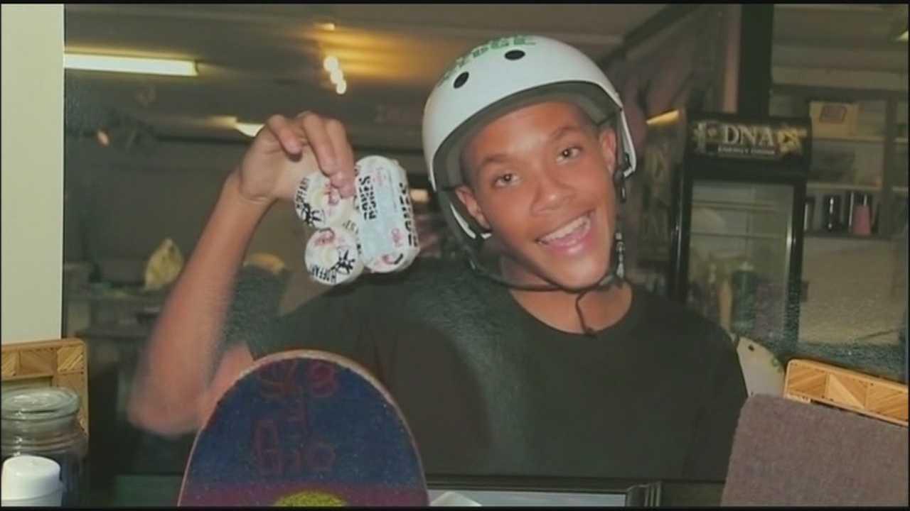 Family, friends mourn boy killed by train at vigil