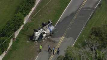 A truck carrying sewage materials overturned in Windermere on Monday afternoon, prompting a hazmat team response.
