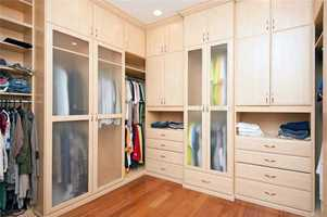 The master closet is not only walk-in but boasts expansive shelving units.