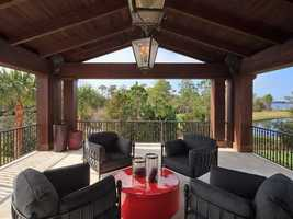 On top of the lanai is a covered balcony looking out over the Lake Nona Club golf course.
