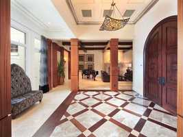 Arched double doors takes you into the foyer.