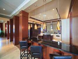 Outside of the kitchen is a sleek dining bar for casual dining.