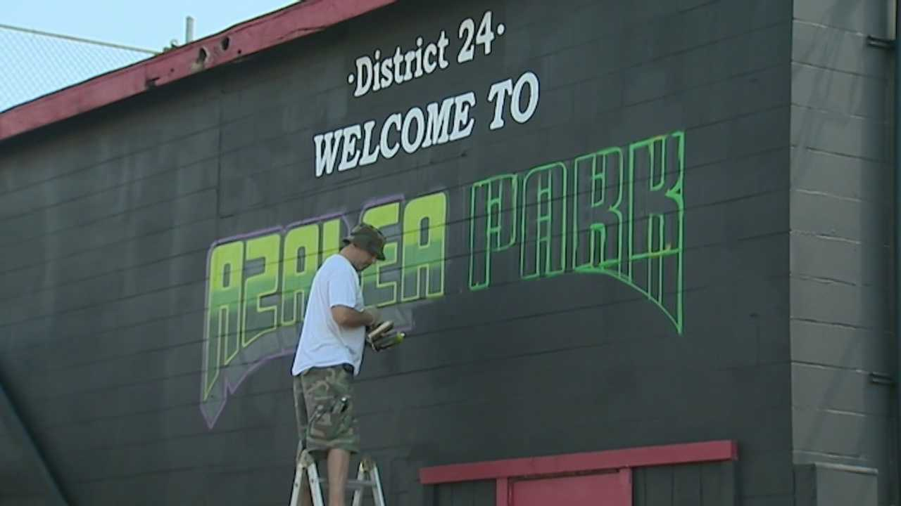 Two New York city spray paint artists repainted the Roberto Clemente mural in Azalea Park.