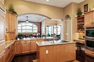 A completely remodeled kitchen is designed with top-quality finishes and materials including appliances, granite, lighting and hardwood floors.