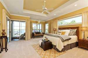 The master bedroom features amazing panoramic views and private access to the patio.