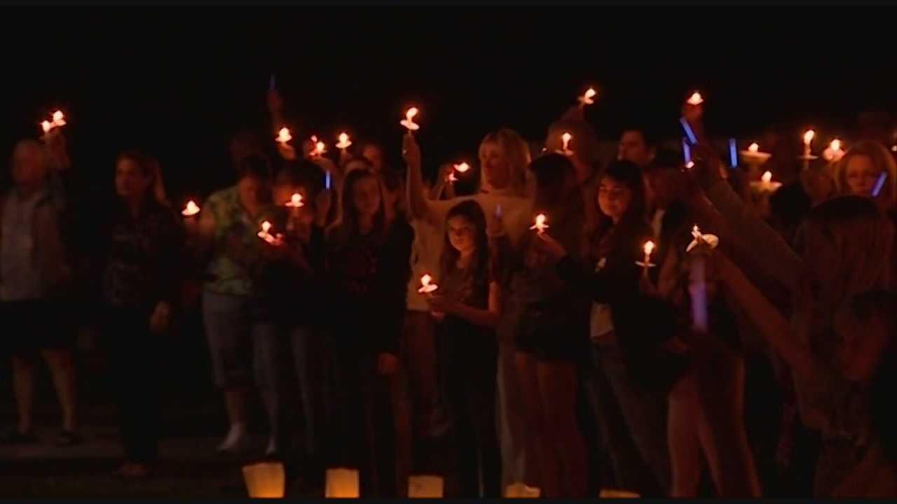 Hundreds gather for candlelight vigil honoring Robert German