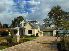 The 6,155 sq. ft. home features a spacious two-car garage.